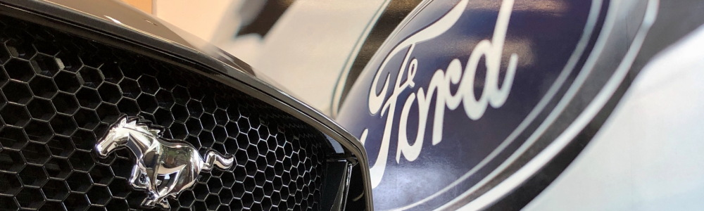 Grille and front pony emblem of Ford Mustang and blue oval